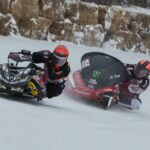 Local TLR Cup Racer Matt Ritchie of Minocqua, WI chases two time world Champion Malcolm Chartier through turn 4 during the 2014 Ironwood Snowmobile Olympus.
